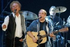 """Simon & Garfunkel was an American duo consisting of singer-songwriter Paul Simon and singer Art Garfunkel. They formed the group Tom & Jerry in 1957 and had their first success with the minor hit """"Hey, Schoolgirl"""". As Simon & Garfunkel, the duo rose to fame in 1965, largely on the strength of the hit single """"The Sound of Silence"""