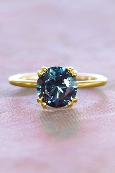 From a minimal luxurious 18k recycled gold band, whisk up four wired prongs presenting a master cut brilliant and untreated natural deep blue sapphire cut in the USA. Set low profile, this custom solitaire engagement ring is perfect for positioning a wedding band flush to it