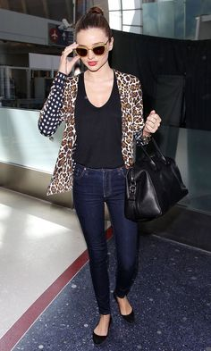 Miranda Kerr wearing animal print jacket with simple black shirt, flat shoes, bag and blue jeans...perfect and comfortable outfit