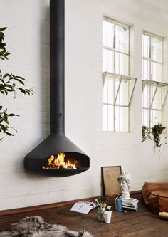First designed in the Antefocus is the suspended fireplace that started it all. This handmade wood burning fireplace is designed to be wall-mounted. Suspended Fireplace, Wall Mounted Fireplace, Open Fireplace, Fireplace Design, Modern Design, Melbourne, Wall Decor, Home Decor, Focus Fireplaces