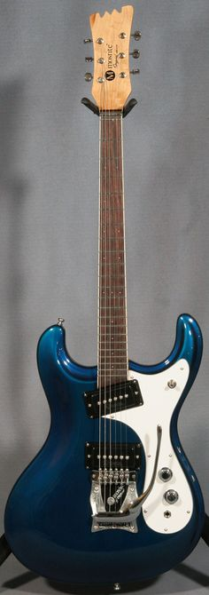 Of course, if I had a couple of grands lying around, I would get the original 1965 (my birth year) Mosrite Ventures series in blue and turne it into a B-52's Ricky Wilson guitar.