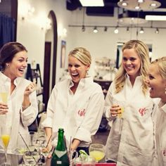 Oversized monogrammed dress shirts for the bridesmaids to get ready in