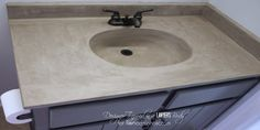 Learn how to transform a cultured marble vanity with concrete on Remodelaholic.com!