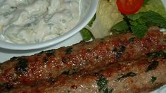 Ground lamb is seasoned with fresh mint and cilantro, and ginger and green chili paste, and made into delicious shish kabobs. Serve with lime wedges, mint chutney, and sliced, sweet Vidalia onions.