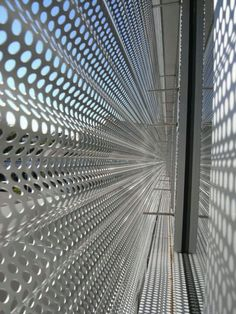 Undulating perforated metal screen
