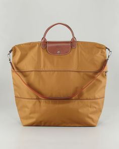 The Longchamp Le Pliage expandable bag is perfect for travel.