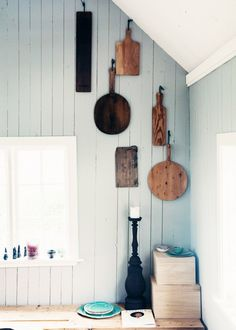 Cutting boards hanging in rustic kitchen