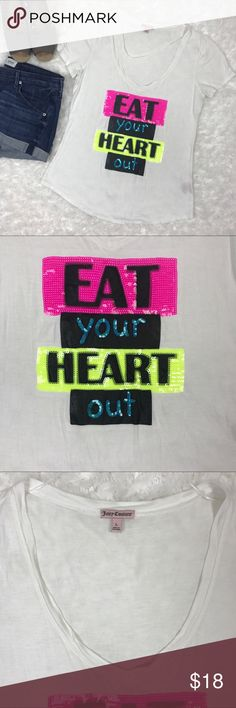 "Juicy Couture Eat Your Heart Out Beaded T-Shirt Juicy Couture White Eat Your Heart Out Sequin TShirt! Fun and fashionable add on to your closet! White v-neck soft lightweight t-shirt with graphic ""eat your heart out"" quote in sequins. 100% rayon. Length measure 25.5"" and 19.5"" in bust. Juicy Couture Tops Tees - Short Sleeve"