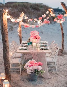 flower garland and string lights for a beach wedding