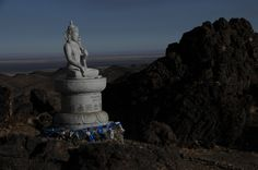 This statue of a buddhist deity was erected by the local community, near a small temple in the Western Beauty Mountains, Gobi Gurvan Saikhan National Park, South Gobi, Mongolia. www.stonehorsemongolia.com