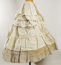 Cage crinoline Date: mid-19th century Culture: probably American Medium: horsehair Petticoats went underneath and above the crinoline, and were trimmed as decoratively as the dress, as seen here. The ruffles around the bottom of this crinoline were common for the time.