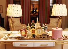 instead of a bar cart, fill a beautiful tray with some of your favorite liquors