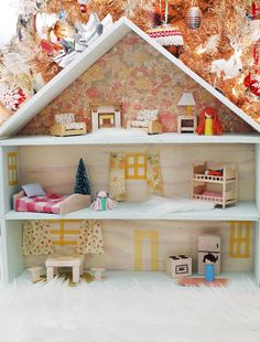 I love the way she made the furniture, curtains and little simple dolls. I great idea if there is ever occation for one of these as a gift. (though usually for girl's, Statler loves teh one at school).