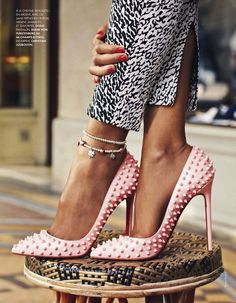 pink stud pumps by Christian Louboutain seen in elle.fr April 19th,2013 issue.