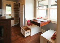 Clever storage ideas: there are drawers under the seats and the table has a built in, fold out extension for company!  @  charlotte-park-cottage-marcus-dipietro-4