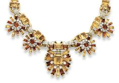 [DETAIL] A RETRO CITRINE AND DIAMOND NECKLACE, BY CARTIER   The front suspending a foliate drop, centering upon a rectangular-cut yellow citrine trimmed by vari-cut diamonds, extending baguette-cut yellow and orange citrine petals, joined by circular-cut diamond links to two smaller clip pendants of similar design, to the yellow and orange rectangular-cut citrine neckchain, mounted in platinum and gold, 14 ins., foliate plaques may be removed and worn as clips, Cartier, Paris #RetroCitrine