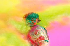 A boy at Holi (Color Throwing) Festival in India. The festival last 16 days but the main day is celebrated by people throwing colored powder and colored water at each other. Holi is also celebrated. Holi Colors, India Colors, Holi Festival India, Holi Festival Of Colours, Celebration Images, Holi Celebration, Hindu Festivals, Indian Festivals, History Of Holi