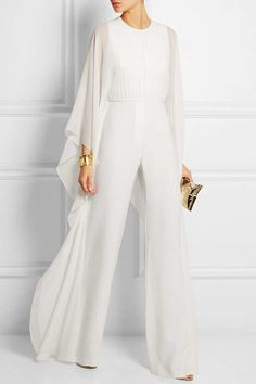 Solid Cape Sleeve Hollow Out Chiffon Wide-Leg Jumpsuit The solid color cape sleeve hollow out chiffon wide leg jumpsuit is a good choice of fashion and it suits many summer occasions. jumpsuit casual,jumpsuit outfit work,how to wear jumpsuit,casual jumpsu Unconventional Wedding Dress, White Fashion, Feminine Fashion, Modest Fashion, Women's Fashion Dresses, Silk Chiffon, Types Of Sleeves, Ideias Fashion, Style Me