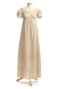 Sprigged cotton dress, with an overall eyelet design and an elaborate scalloped hem border. Charleston Museum