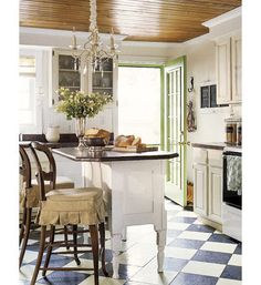 Love the ceiling. Floors are cute and probably very affordable. Traditional kitchen by The Lettered Cottage