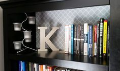 Easy DIY tip: Line the back of your bookshelf with fabric.  Tutorial: Robin Kramer Writes