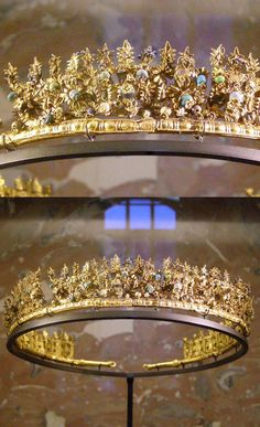 Diadem. Greek, Hellenistic Art (3rd-1st centuries BC). The necropolis in Canosa has provided splendid examples of the refinement of women's jewelry at that time. This features exuberant, richly inventive decoration typical of the floral style developed by Greek goldsmiths in southern Italy. Palmettes, rosettes, and intertwining foliage form a tracery in gold and enamel, worthy of the finest lace. The piece is dotted with tiny colored glass beads. http://www.louvre.fr/en/oeuvre-notices/diadem