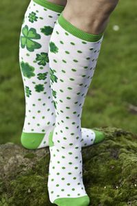 You'll have the luck o' the Irish when you wear these knee high socks covered in polka dots on their fronts leading to four leaf clovers across the backs.