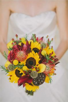 Bright yellow and red bridal bouquet by Mid Valley Florist