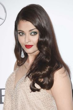 Cannes Film Festival 2014: Aishwarya Rai wore a pair of briolette cut pastel sapphires drop earrings from Chopard's Copacabana Collection that mirrored the beads on her nude-coloured gown
