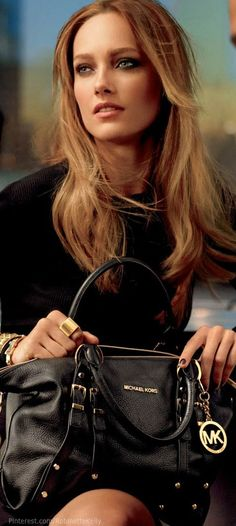 very cute everyday black purse, for those of you who like designer but don't want to throw down a couple thousand, michael kors is a wonderful choice.   Michael Kors Fall 2013