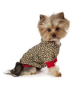 Dress up a special doggy in this daring leopard print pullover. This fierce frock for Fido even features a cozy hood so prima donna pooches can hit the town in posh style.