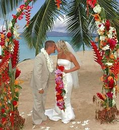 Colorful beach wedding I like these colors - red, sand, palm green, deep blue