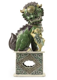 A Chinese famille verte biscuit buddhistic lion - KANGXI (1662-1722)