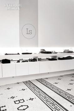 Floor tile-looks like norwegian knitting. Lovely simple logo on wall.