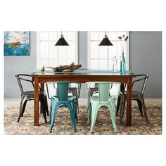 The Threshold Farm Table Dining Collection meshes a rustic wooden table and contrasting metal chairs. The dining room furniture recreates the beauty of an old farmhouse with just the right touch of modern elegance.