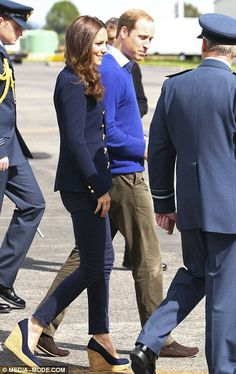 Warm welcome: The Cambridges were met by RNZAF officials after they touched down on the tarmac