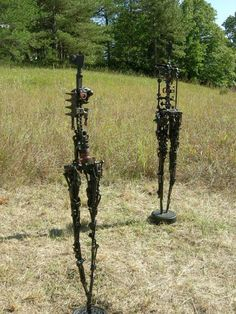 """""""Man and Woman"""" sculpture made from vintage tools"""