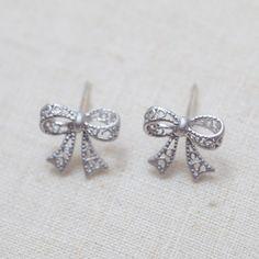 Cute bow stud earrings in silver   $14.00 usd