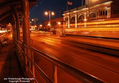 The Night Trolley - the F Line at night on the Embarcadero, San Francisco. Jon Wollenhaupt Photography - Copyright Protected.