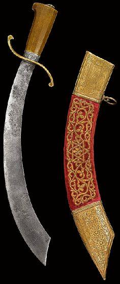 Moroccan maritime cutlass, 17th to 18th century. The steel blade of characteristic form with copper quillons in assymetric curve and engraved silver mount at forte comprising floral motif, the faceted rhino-horn hilt with ribbed-dome finial, wooden scabbard with red-ground velvet and gilt metal-thread embroidery comprising six-point star and vegetal motif, with ensuite engraved copper chape and lock with central rectangular panels comprising floral motifs.