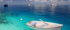 Club Med Kani Maldives giving a boat spa massage holiday..