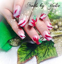 Merry Christmas  Christmas nails.  Candy cane design with 3D poinsettia.  Love Christmas. Expressing her love and family