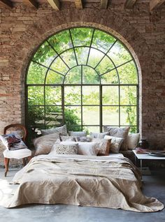 Awesome window and brick bedroom...love it! Pinterest.com/mhdkr