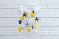 Baby felt mobile yellow white grey stars, baby crib mobile, baby musical mobile star  Cute children's musical mobile of felt with pearls Composition: 100% eco-polyester.  Hypoallergenic material.  Equipment: Cross with toys: Cloud - 4 pcs, moon - 1 pc., Stars - 18 pcs.
