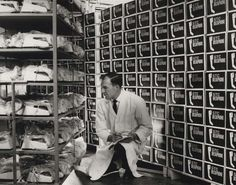 Man checking stocks of STC Deltaphone, Monkstown, c1966. IET Archives NAEST 211/02/28/02 (8832/10 on verso)
