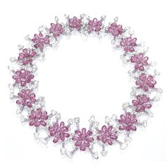 PINK SAPPHIRE AND DIAMOND NECKLACE. Of floral motif, set with clusters of variously-shaped pink sapphires and rose-cut diamonds, the pink sapphires and diamonds together weighing approximately 147.90 and 51.50 carats respectively, mounted in 18 karat white gold, length approximately 440mm.