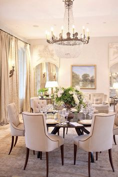 Dining room with round table and tufted dining chairs