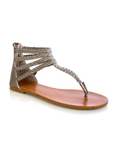 """Strut around in style in these braided fashion gladiator sandals with lurex detail, zip closure behind ankle, flat insole and textured outsole. 1/2"""" heel height. Imported. FINAL SALE, NON-RETURNABLE."""