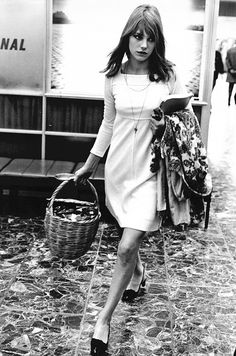 Jane Birkin rocking a simple white dress and basket bag