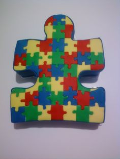 Puzzle piece cake with puzzle pieces on top